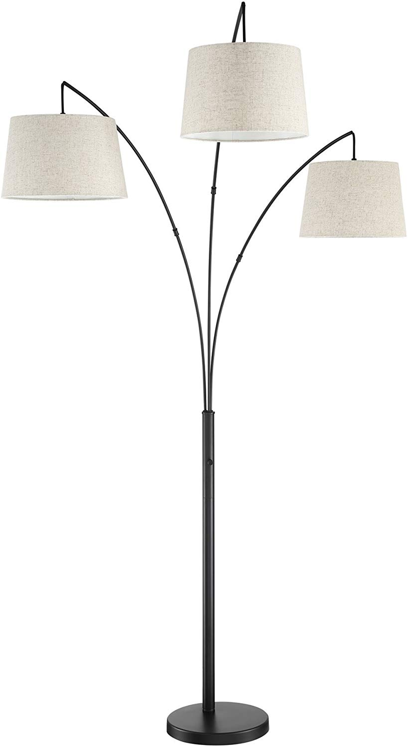a three headed floor lamp with white hanging shades