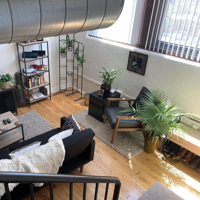 view of living room from the top of the stairs