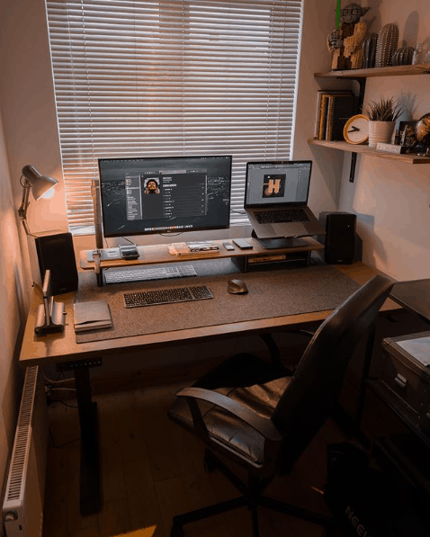 shows a home office setup with monitor, laptop and desk and chair