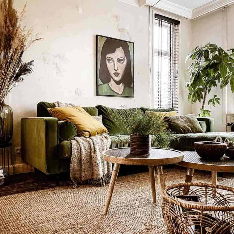 sectional green velvet sofa with coffee table in front