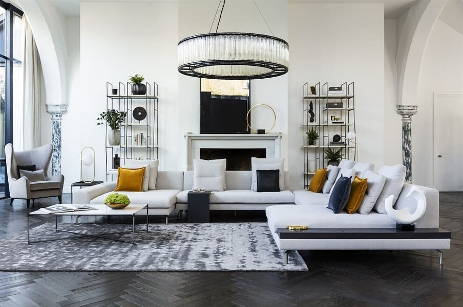 comtemporary living room setting with white walls and furniture and dark floors