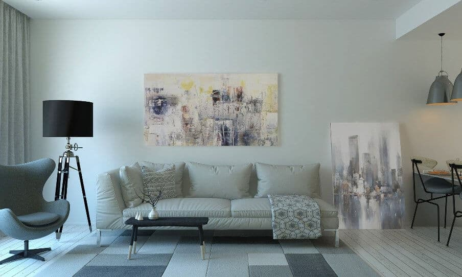 a mid-century style gray sofa and armchair living room setting