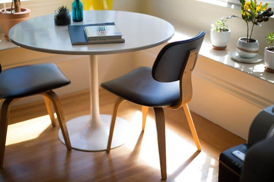 circular dining table and two chairs
