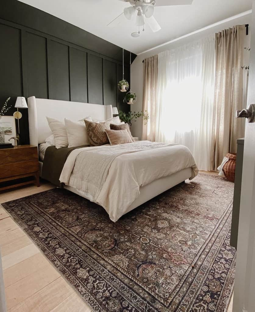 Large bedroom with rug and accent wall