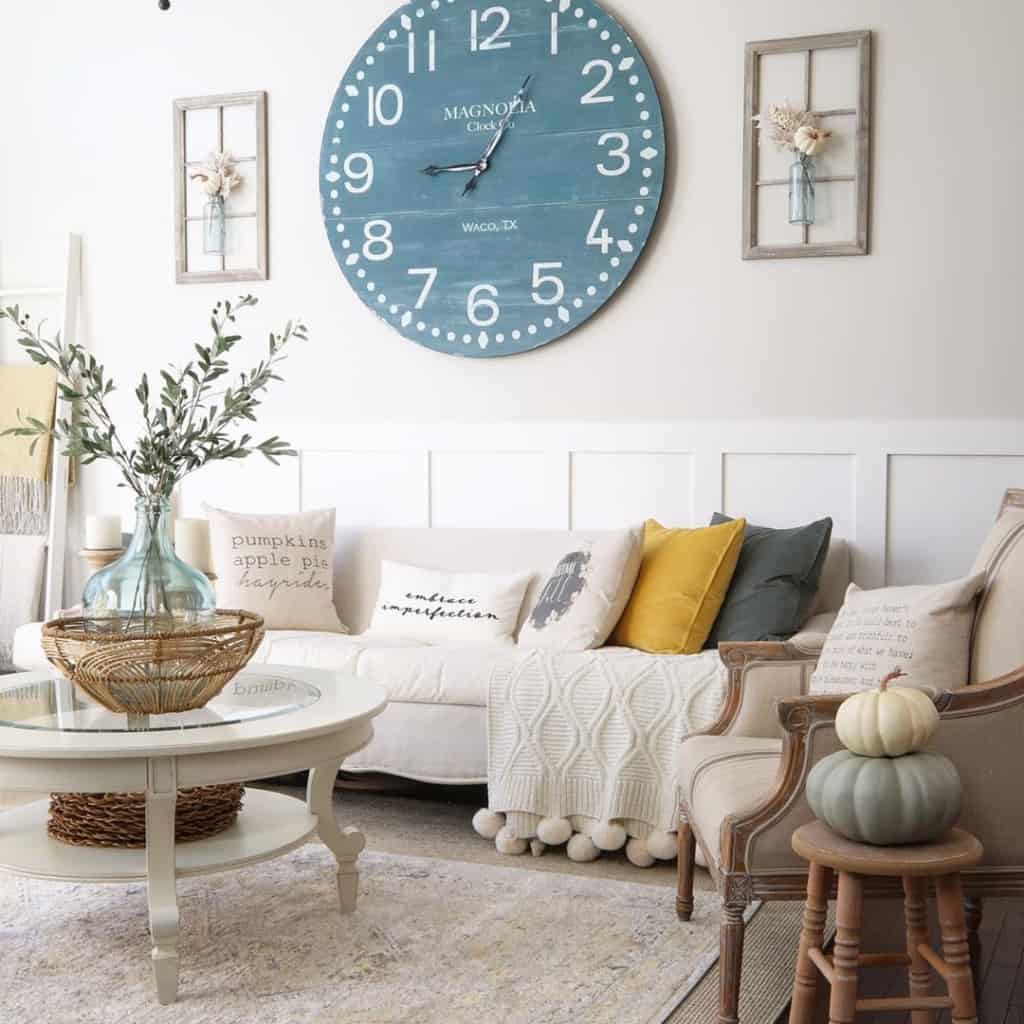 famhouse clock and sofa with coffee table