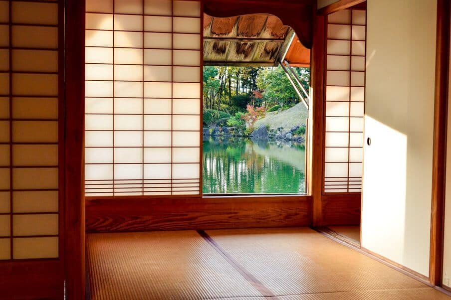 Entrance to a Japanese home and looking through an open door to a pond beyond