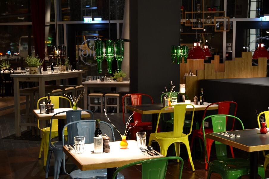 restaurant dining setting with industrial design tables and chairs