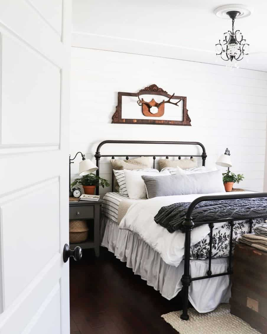 mostly white colored bedroom with a purple throw at the end of the bed