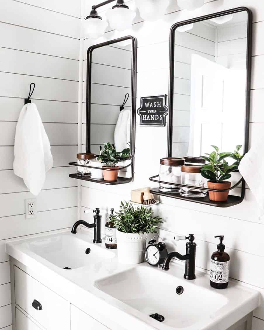 mainly white washroom with black fittings and mirrors in black frames