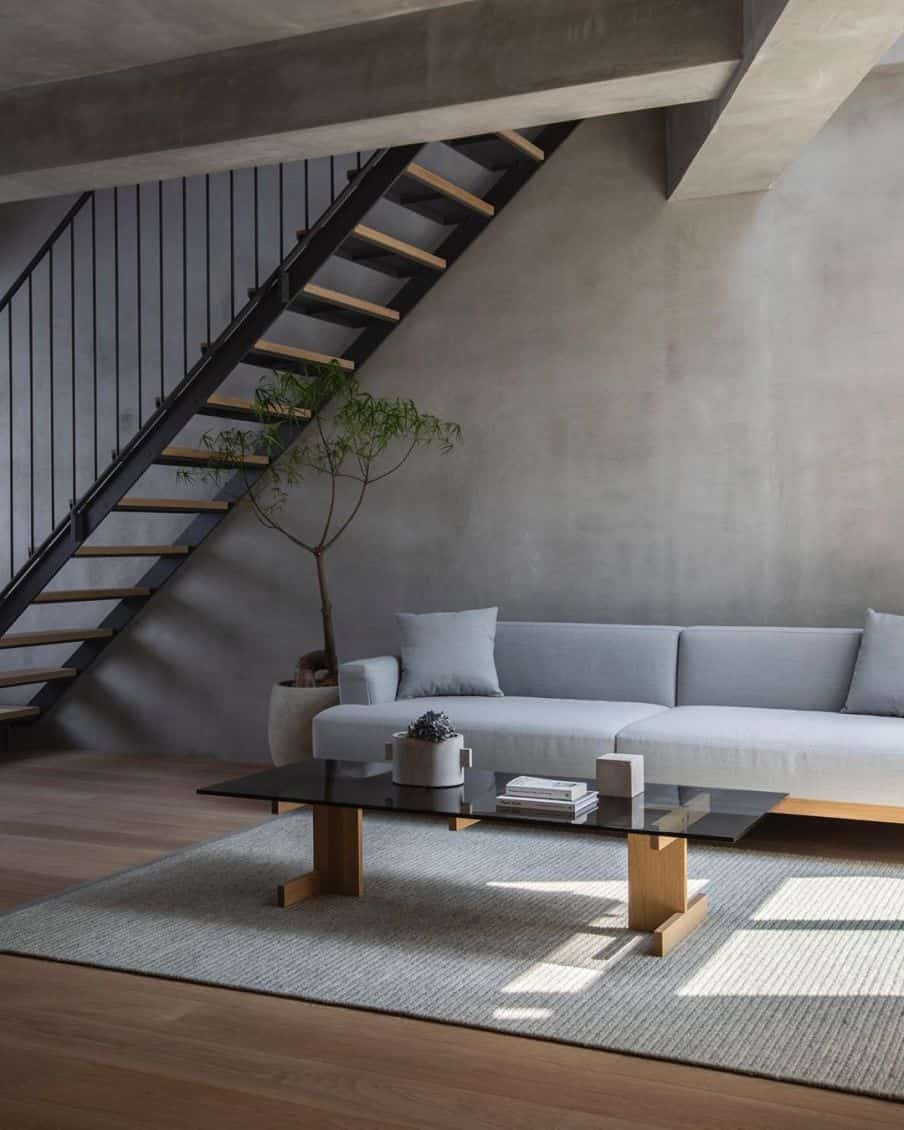 a gray sectional sofa in an open plan area