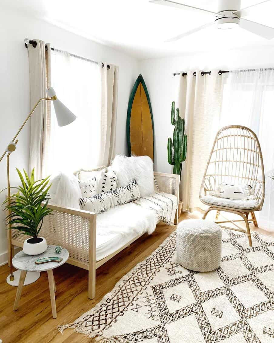 small rattan timber framed white upright sofa on a hardwood floor