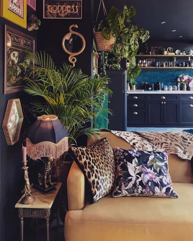 Dark interior with plants and patterned cushions