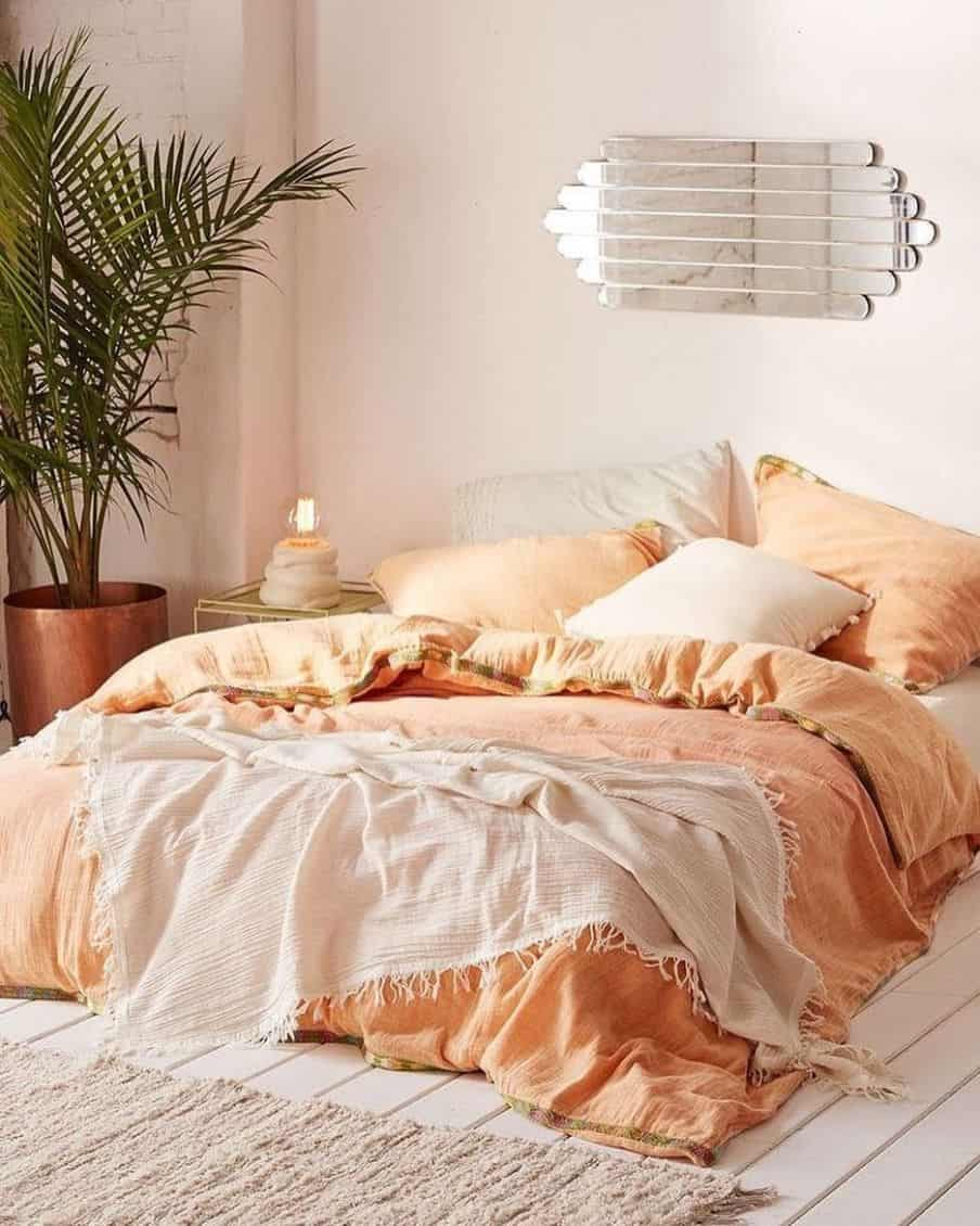 pink throw on peach colored bedding