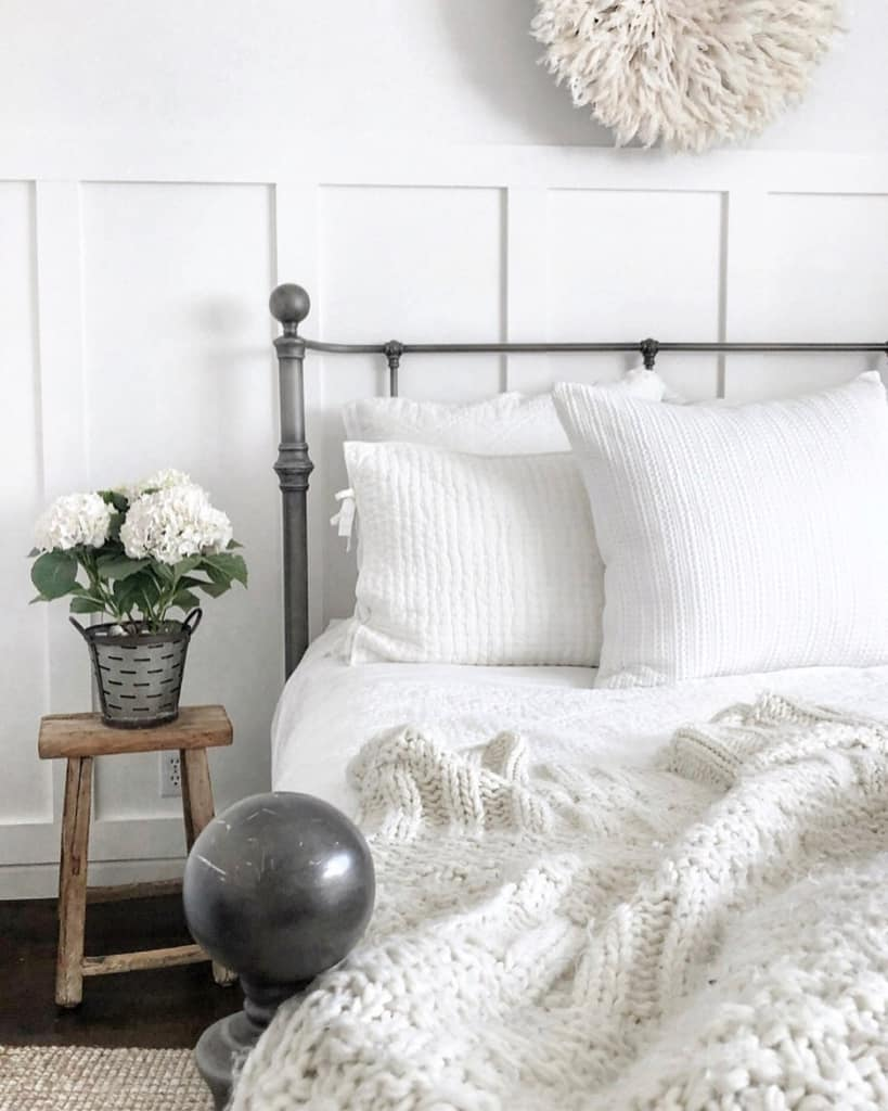 White bedroom with white bedding and throw