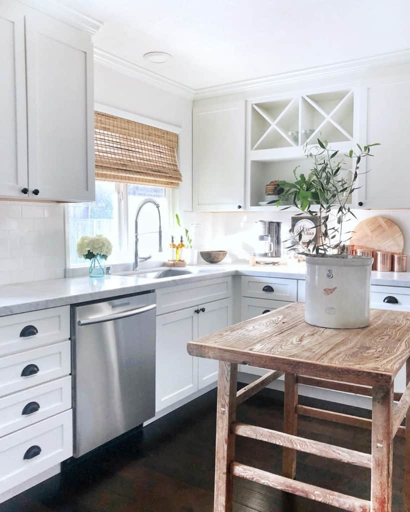 White kitchen with rustic side table