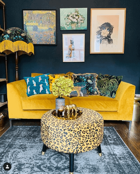 a mustard yellow sofa with cushions
