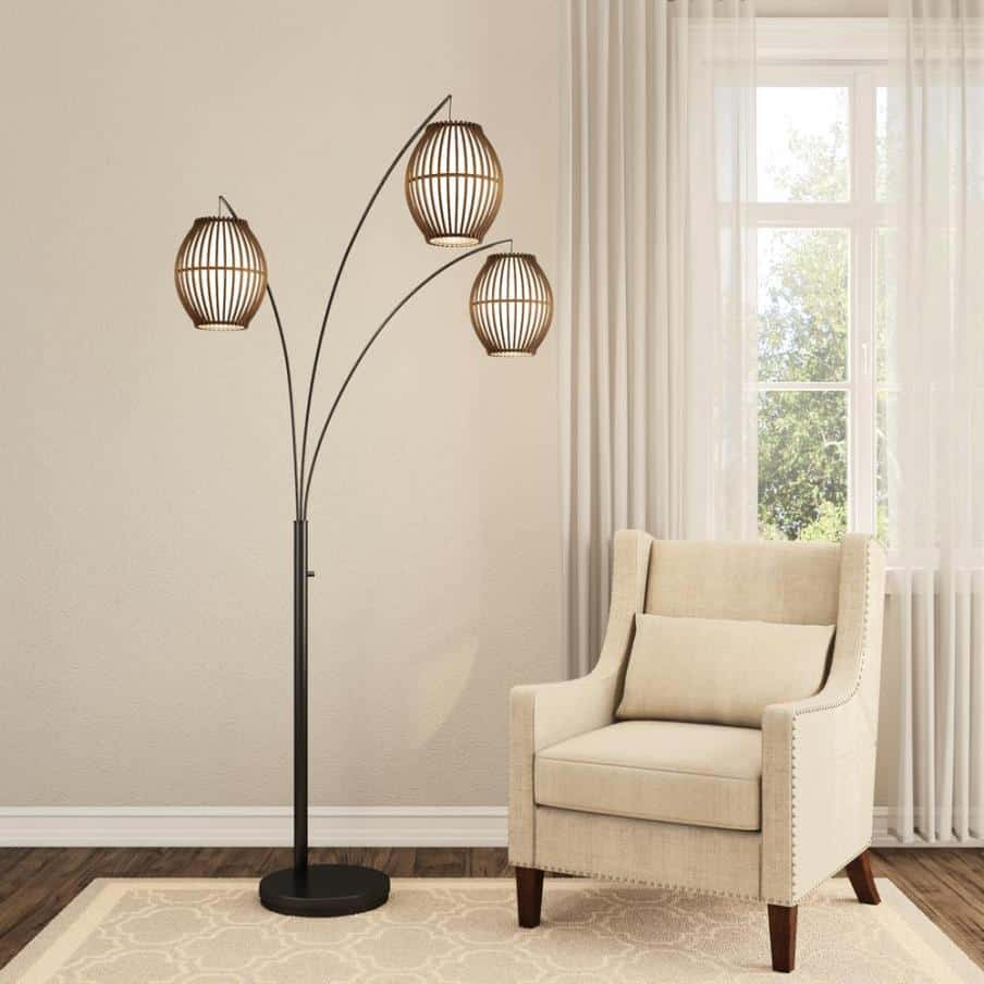 a floor standing lamp with three heads