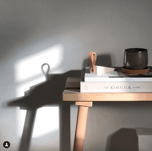 sun lit desk creating shadow