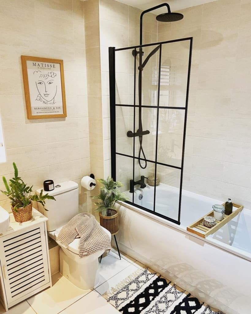 Bathroom with shower in bath and white tiles