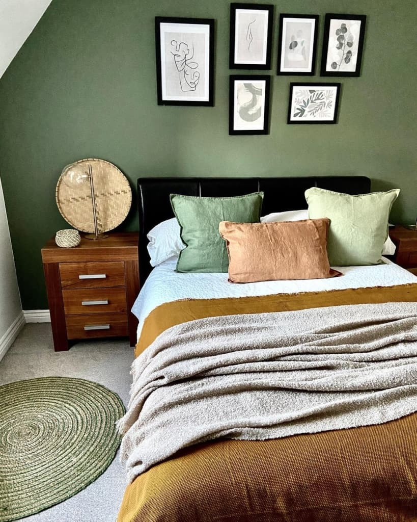 Dark neutral bedroom with gallery wall above bed