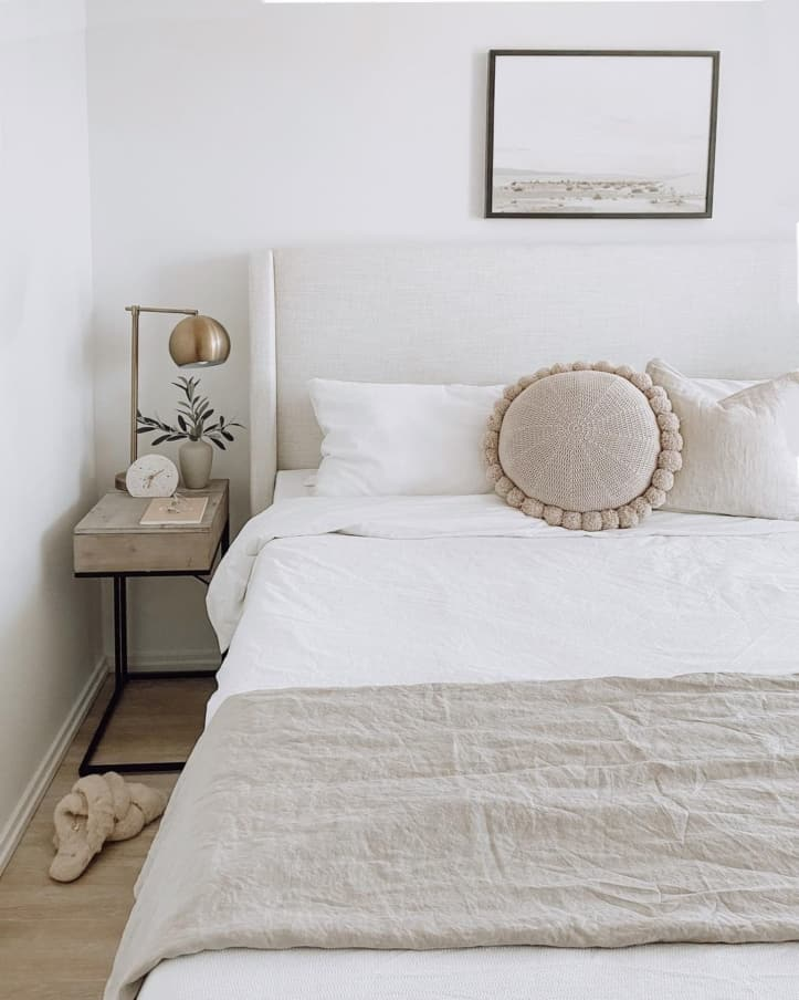 White bedroom with sand throw
