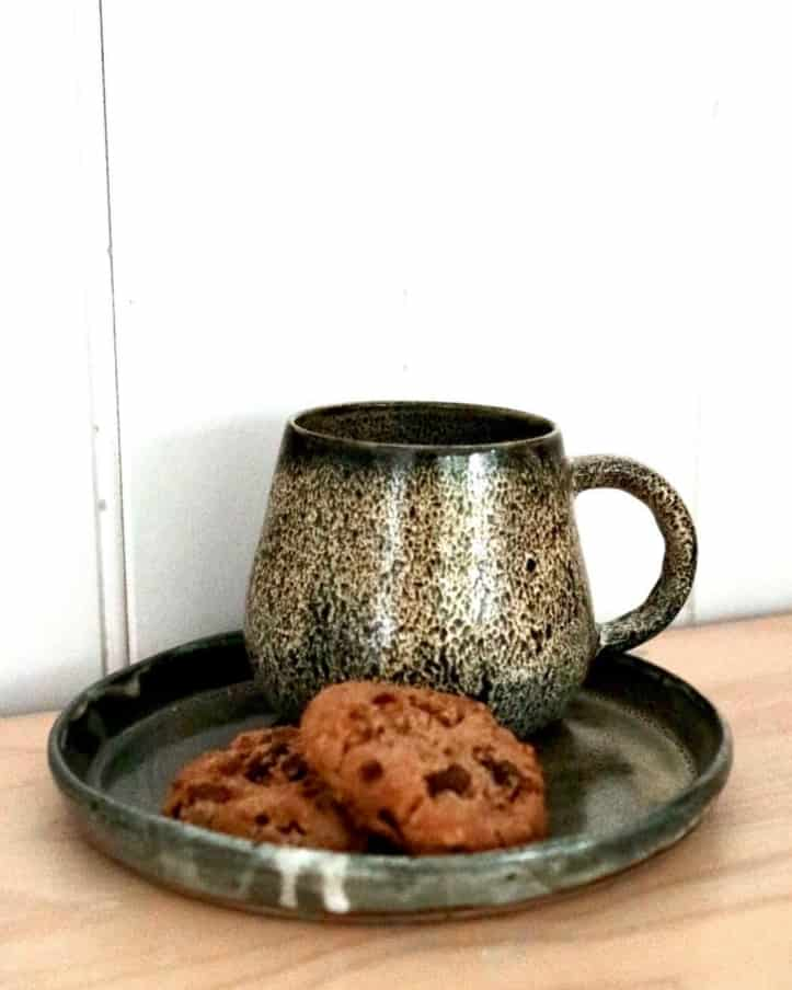 cup and saucer with biscuits