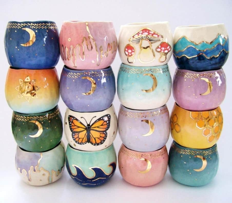 many cups with moons and butterflies