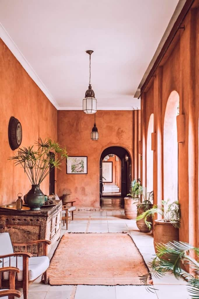 living arear with red brown wall color and arched windows