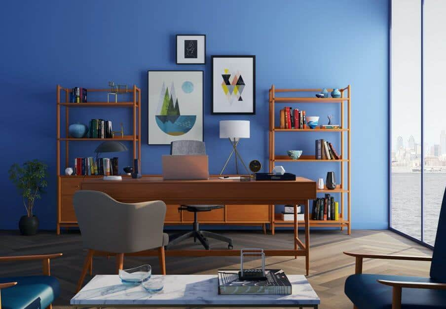 brown desk in home office with blue walls