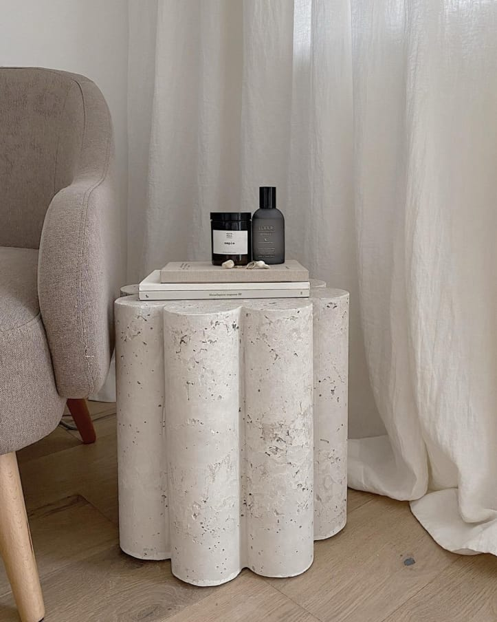 Side table with columns and accent chair