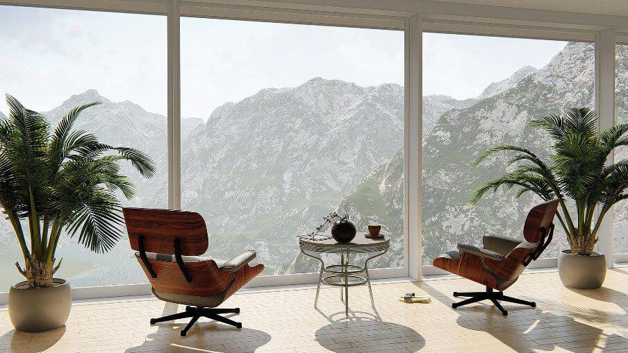 view of a mountain scene through large picture windows of apartment