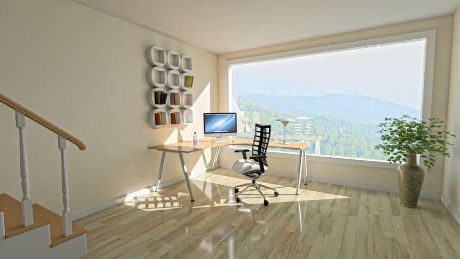 minimalist decor in home office setting with large window behind and spectacular view