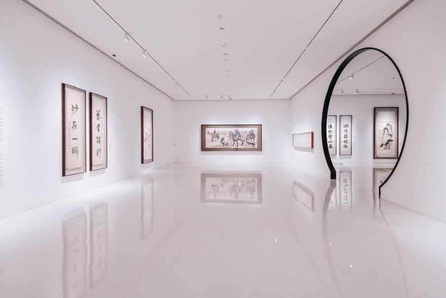 view of an art gallery with white backdrop