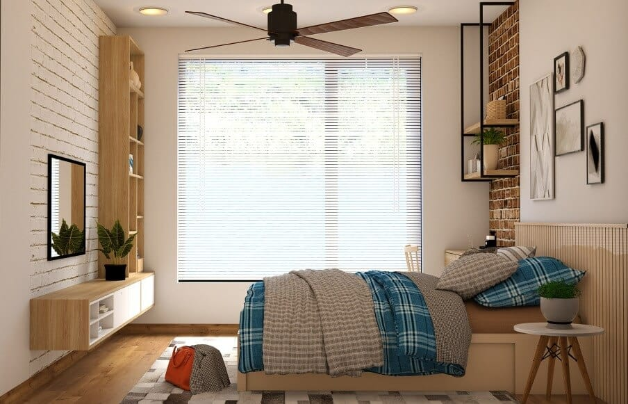 a bedroom with a ceiling fan and minimalist furnishing