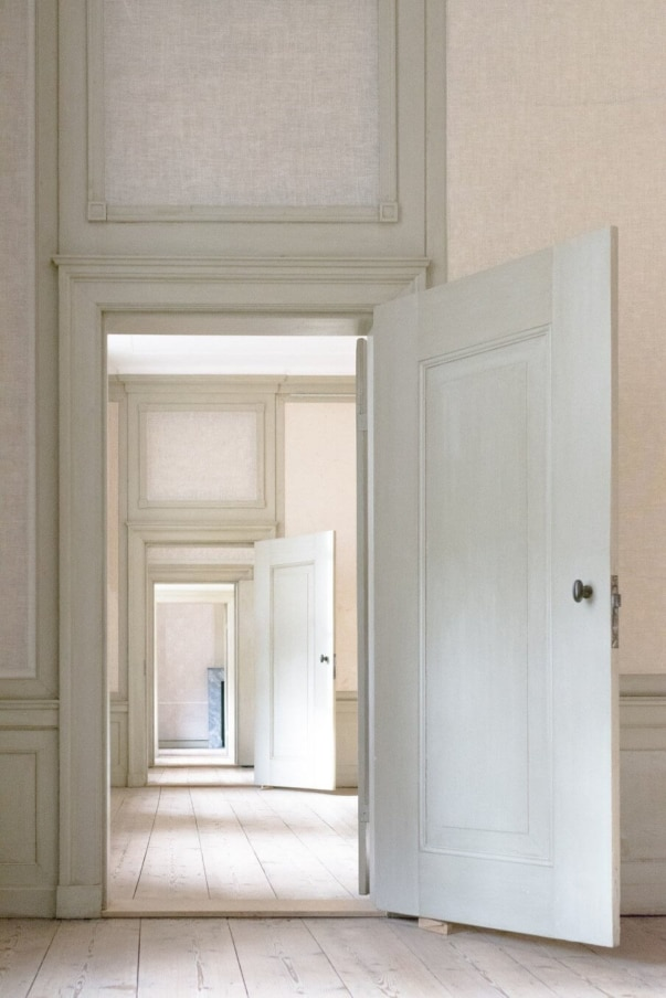 Series of open internal doors with a view through