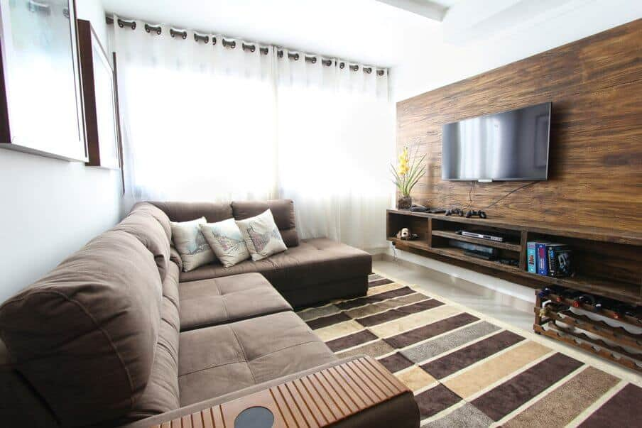 mid century modern living room setting with sectional sofa and wall mounted tv